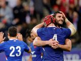 France's Charles Ollivon celebrates avith Bernard Leroux after defeating England during the Six Nations rugby union international match between France and England at the Stade de France in Paris