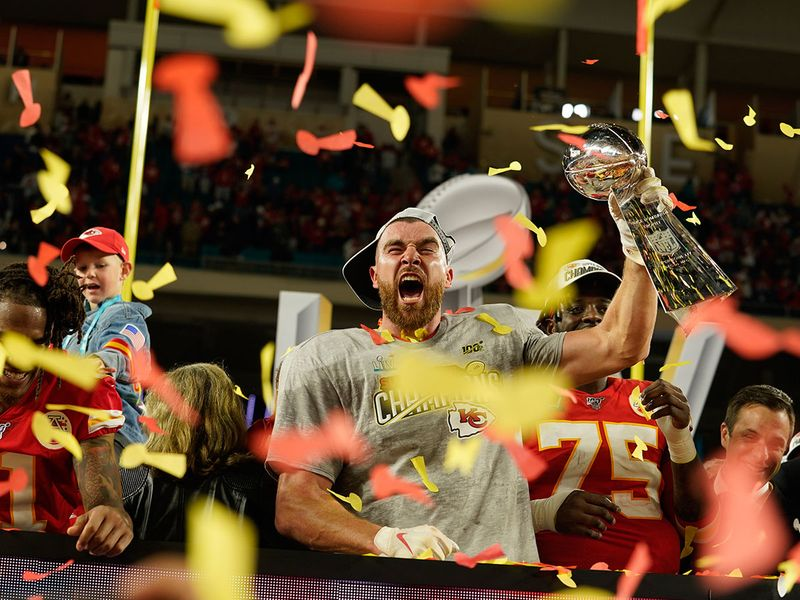 Kansas City Chiefs tight end Travis Kelce celebrates with the Vince Lombardi Trophy after winning Super Bowl LIV