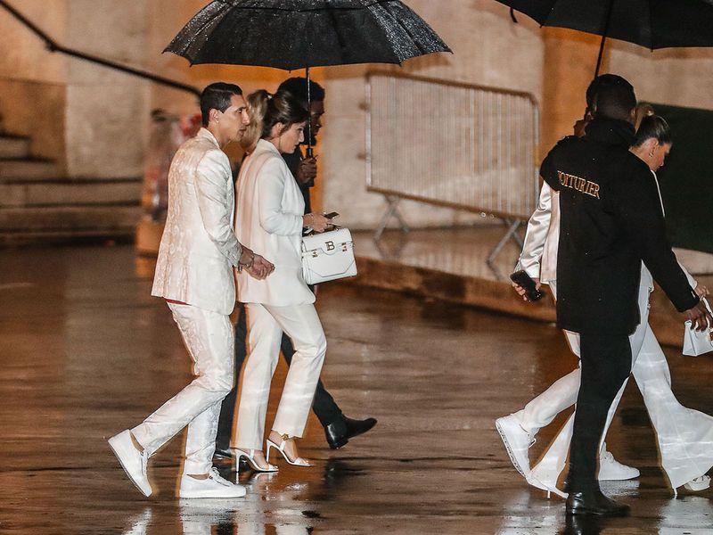 Paris Saint-Germain's Argentine midfielder Angel Di Maria (L) and his wife Jorgelina Cardoso (2nd L) arrive to attend the birthday party of Paris Saint-Germain's Brazilian forward Neymar on February 2, 2020, at the Yoyo in the Palais de Tokyo venue in Paris. / AFP / Zakaria ABDELKAFI
