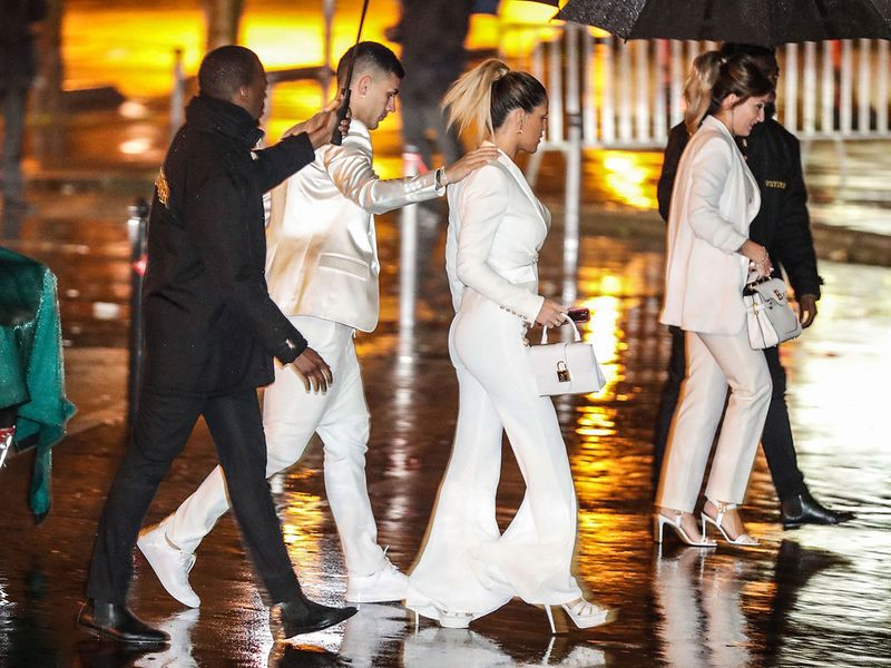 Paris Saint-Germain's Argentine midfielder Leandro Paredes (2nd L) and his wife Camila Galante (2nd R) arrive to  attend the birthday party of Paris Saint-Germain's Brazilian forward Neymar on February 2, 2020, at the Yoyo in the Palais de Tokyo venue in Paris. / AFP / Zakaria ABDELKAFI
