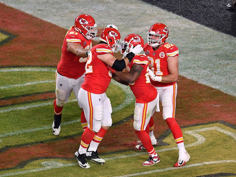 Running back for the Kansas City Chiefs Damien Williams (2nd R) and teammates celebrate after scoring
