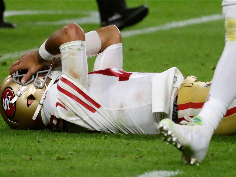 San Francisco 49ers quarterback Jimmy Garoppolo lays on the ground
