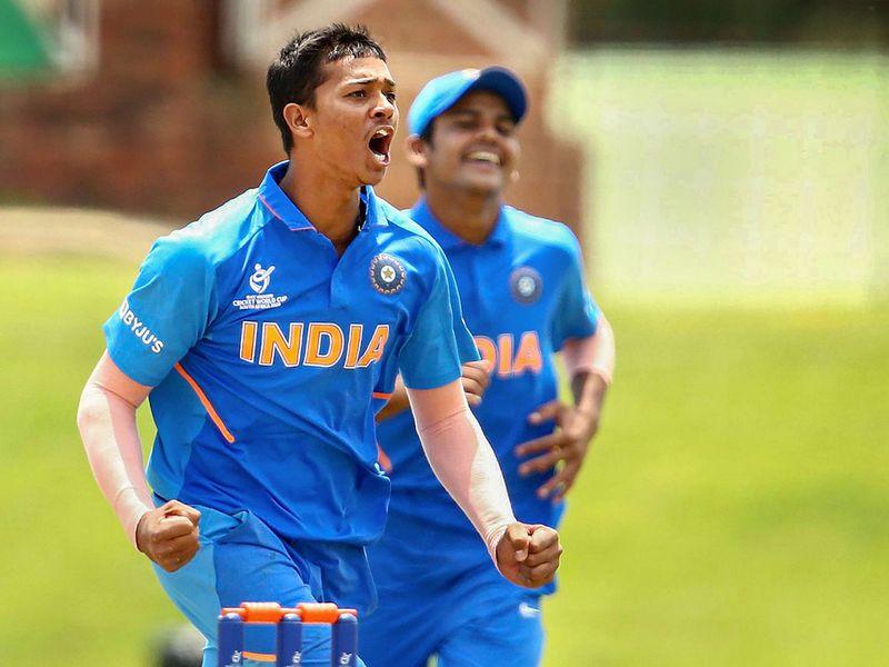 Yashasvi Jaiswal of India celebrates taking the wicket of Haider Ali