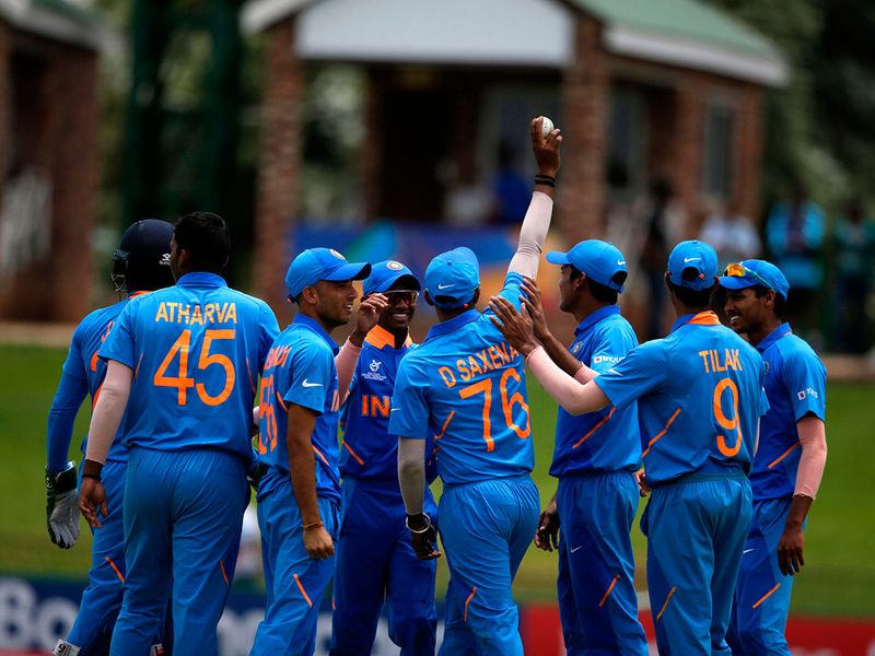 India's Divyaansh Saxena (4th R) celebrates with teammates after he caught out Pakistan's Mohammad Haris off a ball delivered by India's Atharva Ankolekar