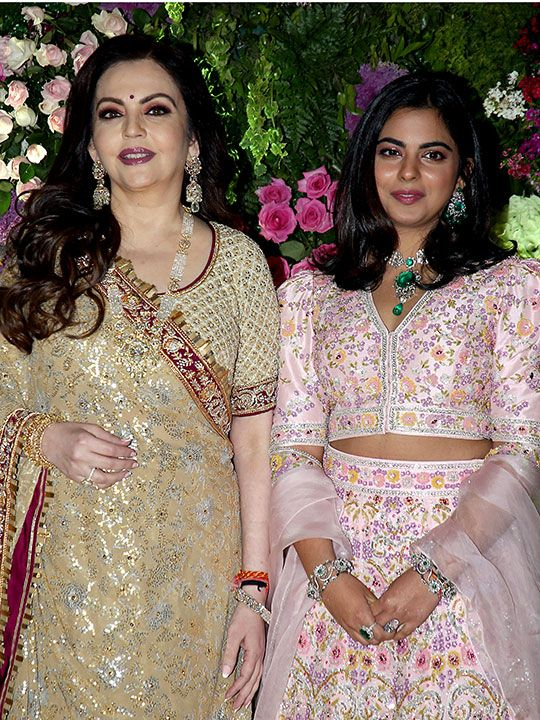Nita Ambani and Isha Ambani attend the wedding.