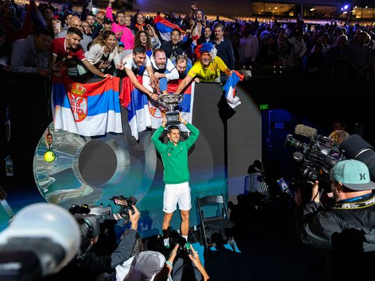 Novak Djokovic of Serbia holds the trophy after defeating Austria's Dominic Thiem to win the Australian Open