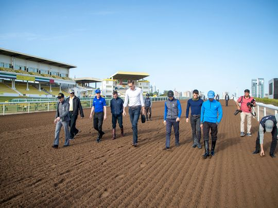 Officials from the ERA led by Chief Steward Sam Shinsky assessing the track condition at Jebel Ali Racecourse
