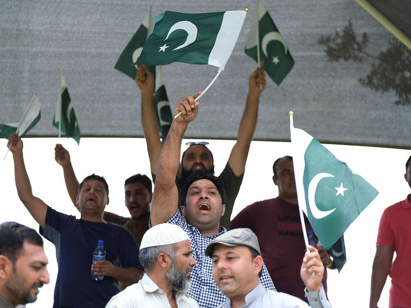 Pakistan fans cheer their team against India in South Africa