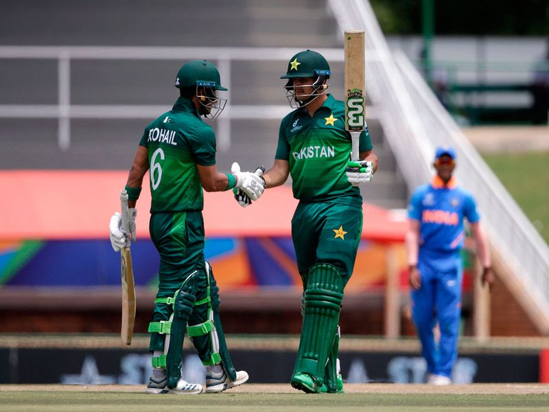 Pakistan's Haider Ali (R) is congratulated by Pakistan's captain Rohail Nazir after scoring a half-century