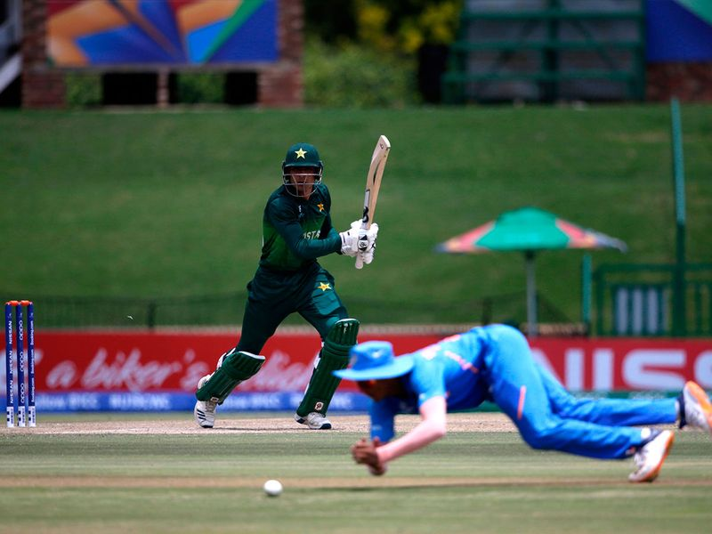 Pakistan's captain Rohail Nazir watches the ball after playing a shot as India's Yashasvi Jaiswal misses the catch