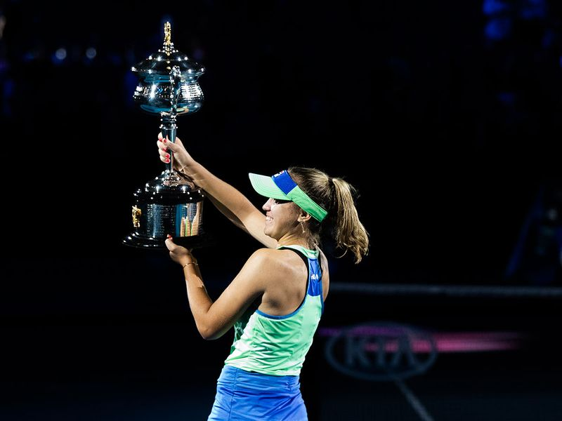 Sofia Kenin of the United States lifts the trophy after defeating Spain's Garbiñe Muguruza to win the Australian Open