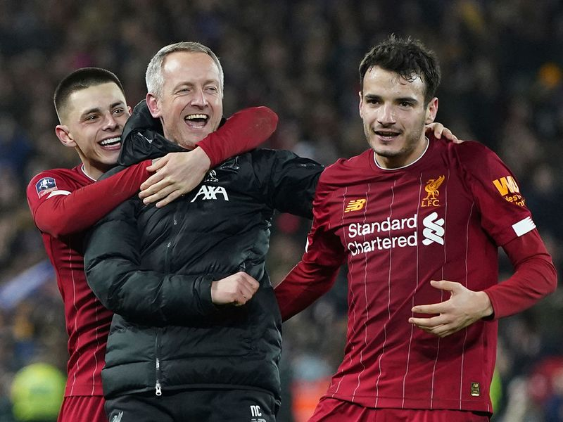 Liverpool's Under 23 coach Neil Critchley, center, celebrates with Liverpool's Pedro Chirivella, right, and Liverpool's Adam Lewis