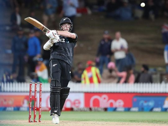 New Zealand's Mitchell Santner bats during the first ODI against India in Hamilton