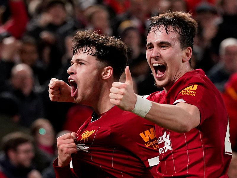 Soccer Football -  FA Cup Fourth Round Replay - Liverpool v Shrewsbury Town  - Anfield, Liverpool, Britain - February 4, 2020  Liverpool's Neco Williams and Liam Millar celebrate after Shrewsbury Town's Ro-Shaun Williams scored an own goal and the first for Liverpool        REUTERS/Andrew Yates