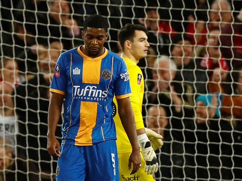 Soccer Football -  FA Cup Fourth Round Replay - Liverpool v Shrewsbury Town  - Anfield, Liverpool, Britain - February 4, 2020  Shrewsbury Town's Ro-Shaun Williams looks dejected after scoring an own goal and the first for Liverpool         Action Images via Reuters/Jason Cairnduff