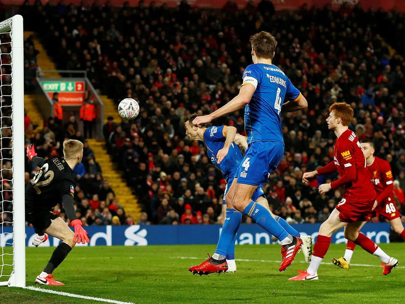 Soccer Football -  FA Cup Fourth Round Replay - Liverpool v Shrewsbury Town  - Anfield, Liverpool, Britain - February 4, 2020  Shrewsbury Town's Shaun Whalley scores their first goal before it is ruled out by VAR       Action Images via Reuters/Jason Cairnduff