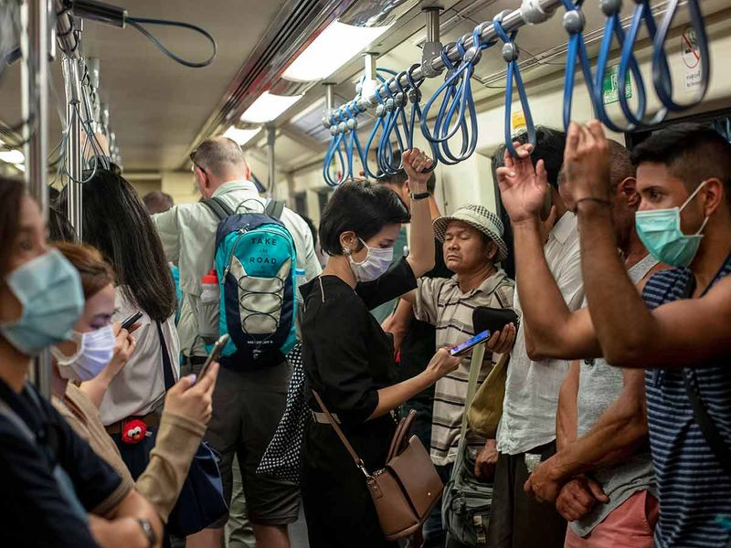 Commuters wear face masks