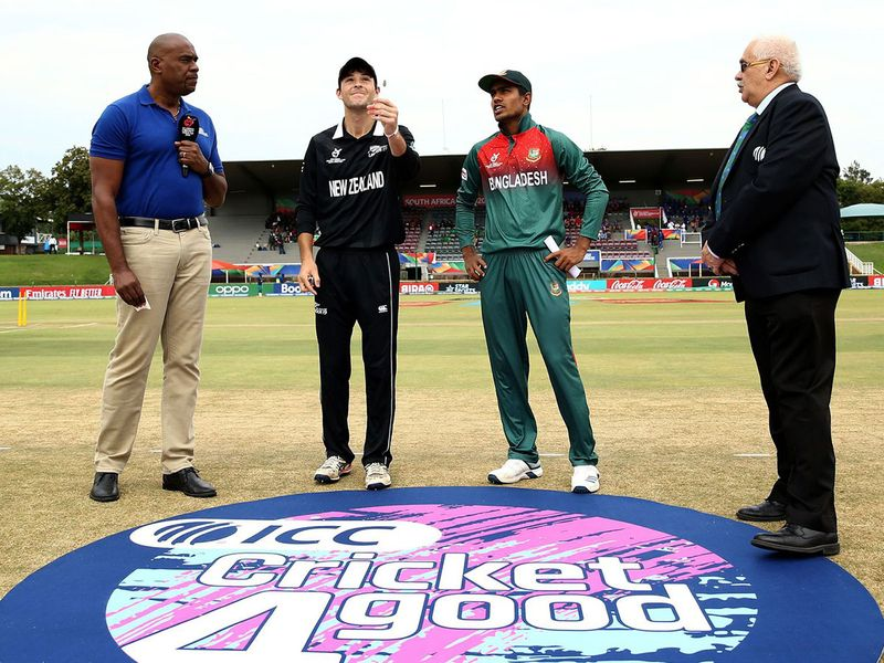 Jesse Tashkoff of New Zealand tosses the coin with Mohammad Akbar Ali of Bangladesh looking on during the ICC U19 Cricket World Cup Super League Semi-Final match between New Zealand and Bangladesh at JB Marks Oval on February 06, 2020