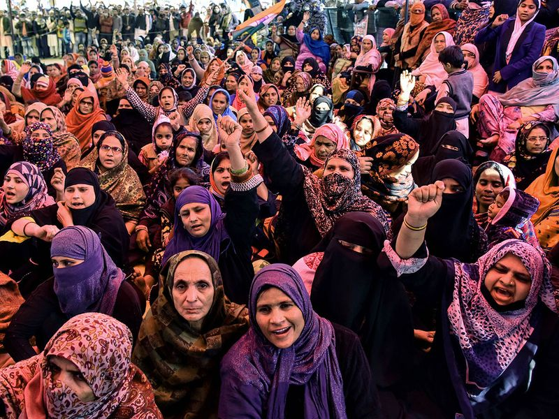 Muslim women shout slogans against India's new citizenship law, during a protest at Shaheen Bagh area  near the Jamia Millia Islamia university in New Delhi on Wednesday.