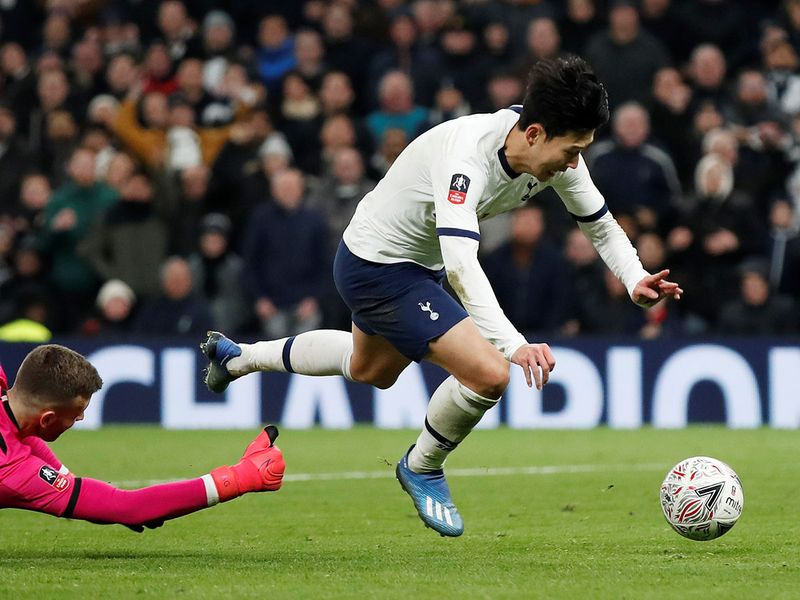 Soccer Football -  FA Cup Fourth Round Replay - Tottenham Hotspur v Southampton  - Tottenham Hotspur Stadium, London, Britain - February 5, 2020   Tottenham Hotspur's Son Heung-min is fouled by Southampton's Angus Gunn resulting in a penalty
