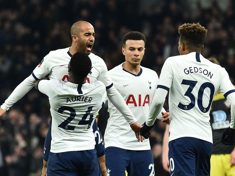 Tottenham Hotspur's Brazilian midfielder Lucas Moura (L) celebrates scoring his team's second goal during the English FA Cup fourth round replay football match between Tottenham Hotspur and Southampton at Tottenham Hotspur Stadium in London, on February 5, 2020