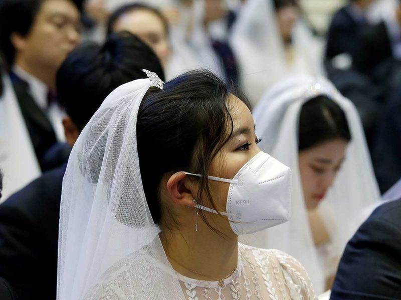 Copy-of-2020-02-07T065543Z_169352119_RC2IVE931XGI_RTRMADP_3_CHINA-HEALTH-SOUTHKOREA-MASSWEDDING-(Read-Only)