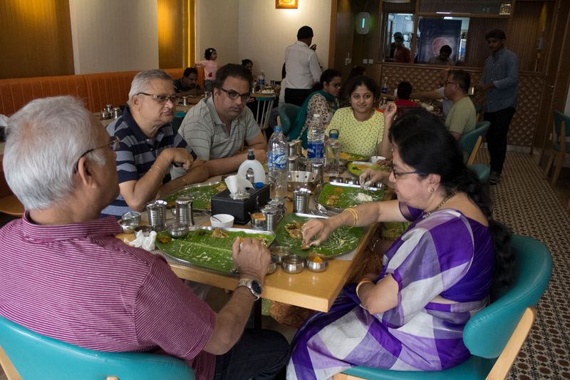 Diners at Sri Krishna Bhavan Restaurant in Karama.