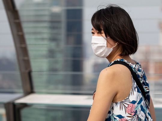 A woman wearing a protective mask