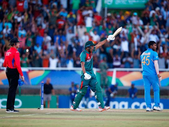 Bangladesh's Rakibul Hasan (C) celebrates after scoring the winning runs as India's Atharva Ankolekar and umpire Sam Nogajski (L) looks on at during the ICC Under-19 World Cup cricket finals at the Senwes Park, in Potchefstroom, on February 9, 2020.