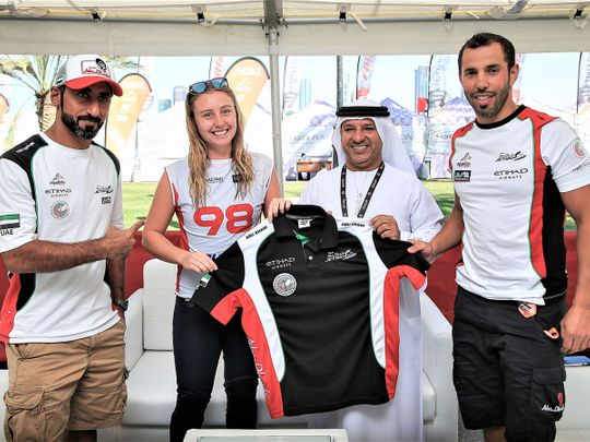 Emma-Nellie Ortendahl with Salem Al Remeithi, General Manager of Abu Dhabi International Marine Sports Club, and new teammates Rashid Al Mulla (left) and Rashed Al Tayer
