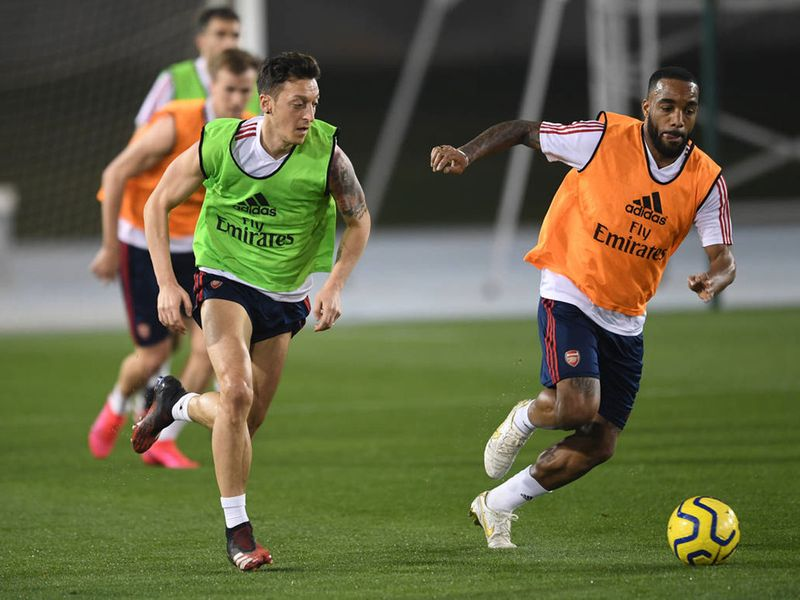 Ozil, pictured with Alexandre Lacazette, will be keen to impress Arteta, having seen a dip in form recently