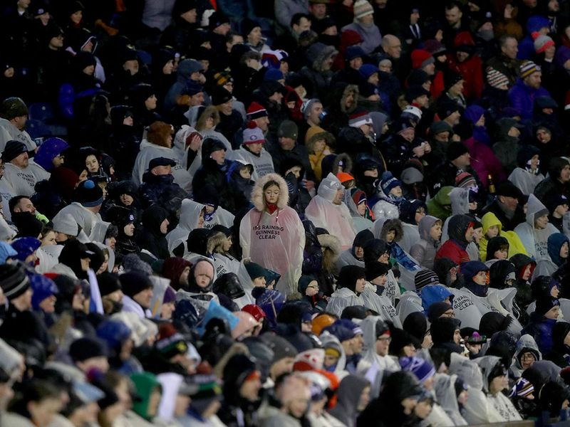 The fans were wrapped up in waterproofs as strong gales and heavy rains battered Scotland during the game