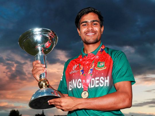 Bangladesh U19 cricket team captain  Mohammad Akbar Ali  pose with the ICC U19 Cricket World Cup trophy after Bangladesh beat India by 3 wickets in the Super League Final