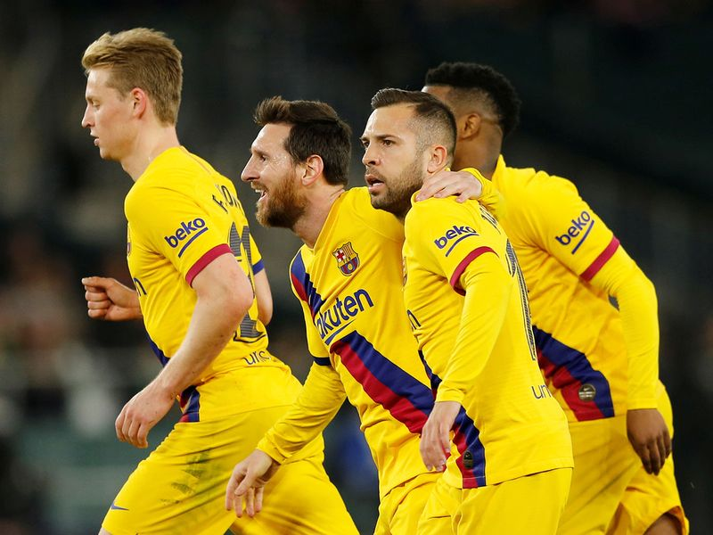 Barcelona came back twice from a goal down before Clement Lenglet's second half header gave them a 3-2 win away to Betis that keeps them within three points of Real Madrid at the top of La Liga