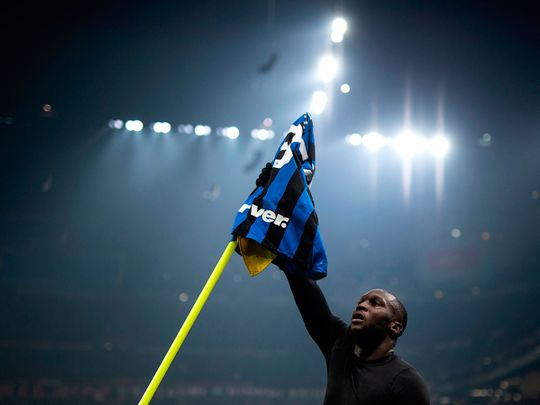 Inter Milan's forward Romelu Lukaku from Belgium  celebrates after scoring during  the Italian Serie A football match Inter Milan vs AC Milan on February 9, 2020 at the San Siro stadium in Milan. / AFP / MARCO BERTORELLO