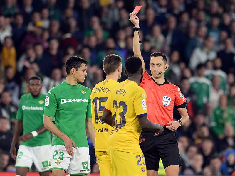 Match-winner Lenglet was sent off for Barcelona in a feisty contest but they managed to hold on