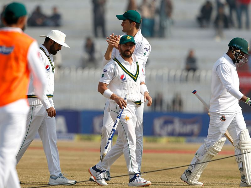 Pakistan player Yasir Shah, center, and others hold wickets after winning the 1st test cricket match against Bangladesh at Rawalpindi cricket stadium in Rawalpindi, Pakistan, Monday, Feb. 10, 2020. (AP Photo/Anjum Naveed)