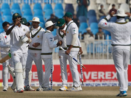 Pakistan players congratulate each others after winning the 1st test cricket match against Bangladesh at Rawalpindi cricket stadium in Rawalpindi, Pakistan, Monday, Feb. 10, 2020. (AP Photo/Anjum Naveed)