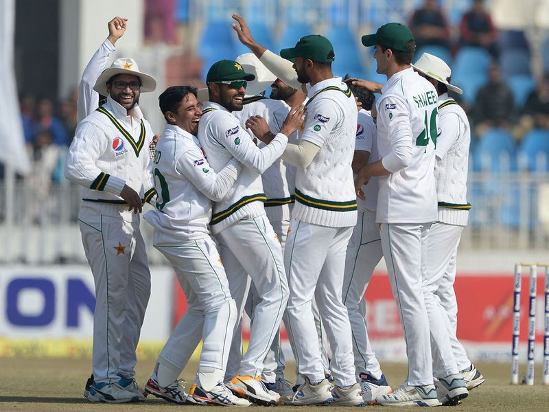 Pakistan's cricketers celebrate after the dismissal of Bangladesh's Rubel Hossain during the fourth day of the first Test in Rawalpindi