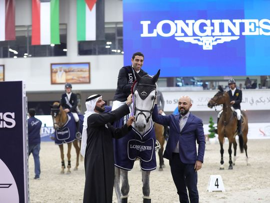 Patrick Aoun, Regional Brand Manager of Longines, right, principal sponsor of the HH Sharjah Grand Prize and Sultan Al Yahyaee, General Manager of Sharjah Equestrian & Racing Club and Championship Manager, left, with Egypt's Abdel Said