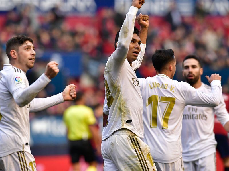 Real Madrid's celebrate their team victory during the Spanish La Liga soccer match between Osasuna and Real Madrid at El Sadar stadium in Pamplona, northern Spain, Sunday, Feb. 9, 2020. (AP Photo/Alvaro Barrientos)
