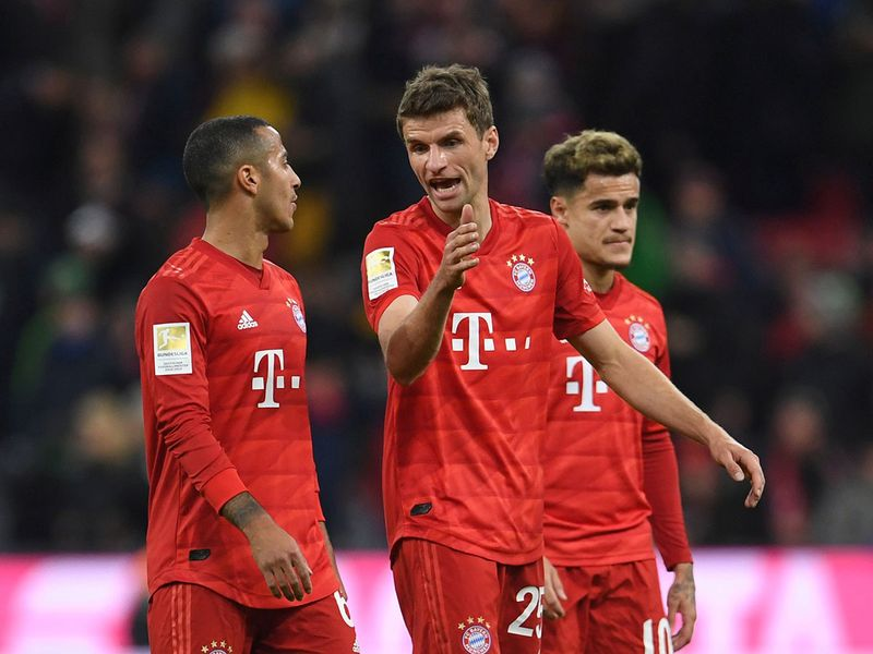 Soccer Football - Bundesliga - Bayern Munich v RB Leipzig - Allianz Arena, Munich, Germany - February 9, 2020  Bayern Munich's Thiago and Thomas Muller after the match  REUTERS/Andreas Gebert  DFL regulations prohibit any use of photographs as image sequences and/or quasi-video