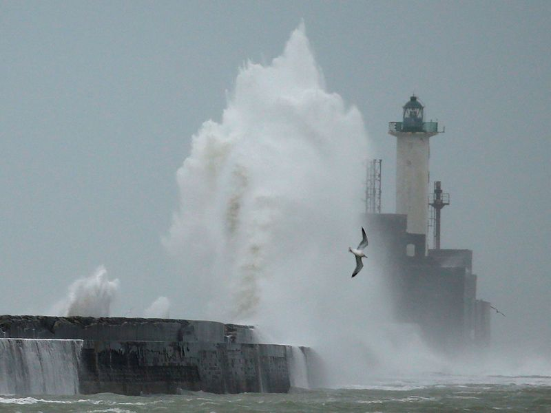 Waves crash against a lighthouse during Storm Ciara at Boulogne-sur-Mer, France.
