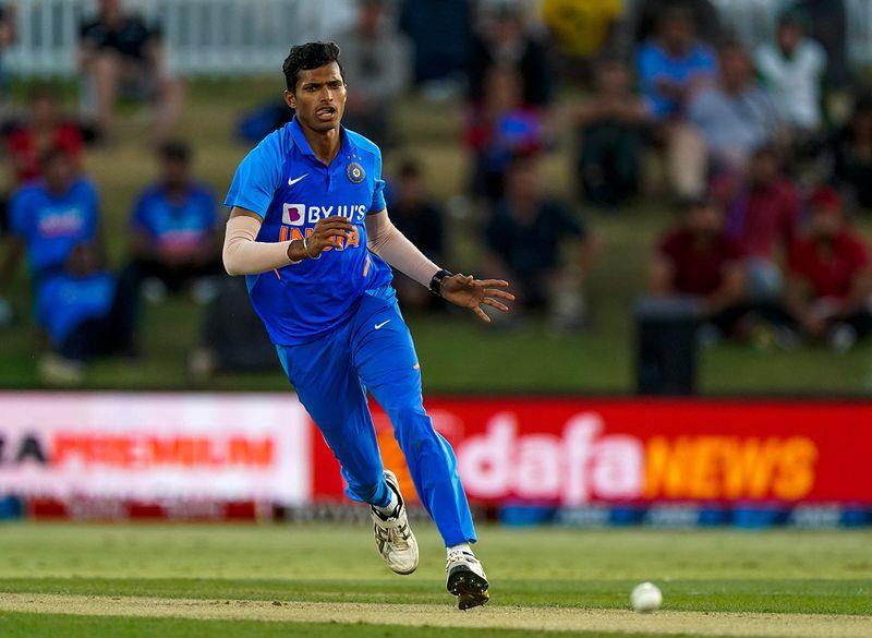 India's Navdeep Saini runs for the ball