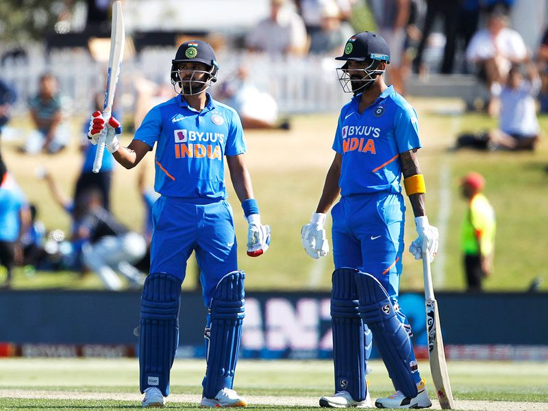 India's Shreyas Iyer (L) celebrates his half-century with KL Rahul during the third ODI between India and New Zealand at Bay Oval