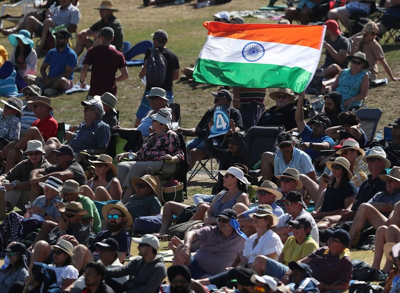 Indian fans fly their flag during the third one-day international cricket match between New Zealand and India at the Bay Oval in Mount Maunganui on February 11, 2020. / AFP / MICHAEL BRADLEY