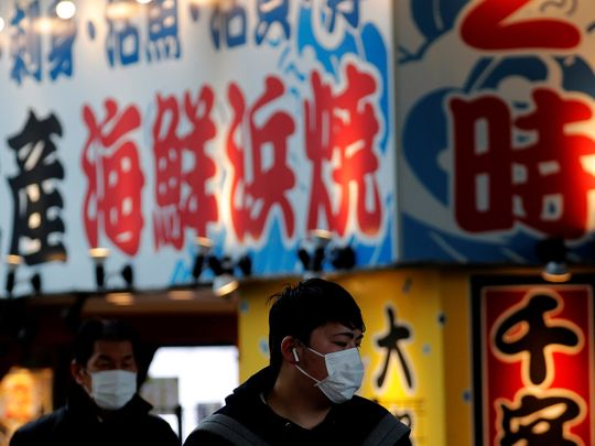 Pedestrians wearing surgical masks make their way in front of Yokohama station in Yokohama, south of Tokyo, Japan February 5, 2020. REUTERS/Kim Kyung-Hoon