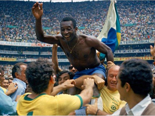 Pele celebrates after winning his third World Cup with Brazil in 1970