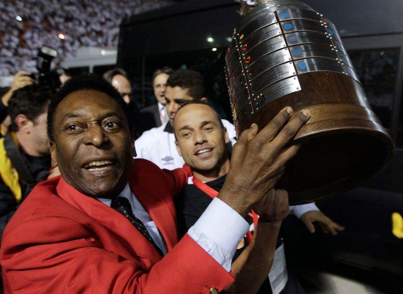 Pele with Santos trophy