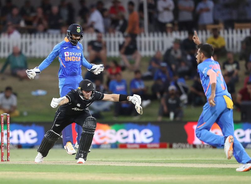 Rahul and Yuzvendra Chahal celebrate the dismissal of New Zealand's Martin Gutpill at the Bay Oval